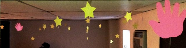Five-inch wide yellow paper stars hanging from my ceiling.