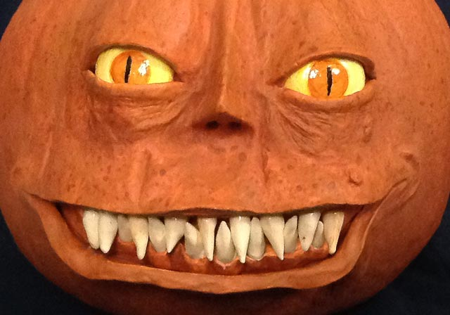 Pumpkin with a molded face.