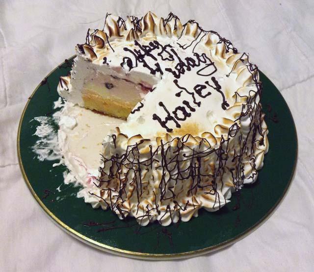 A baked Alaska, missing a slice.