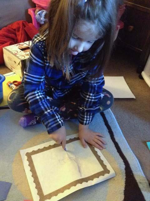 Granddaughter at work, drawing.